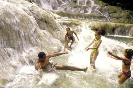 Family frollicks in Dunn's River Falls. © Jamaica Tourist Board